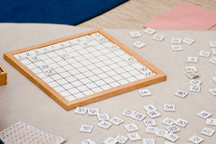 Montessori Hundred Board. Educational material used for teaching the number sequence from 1 to 100 royalty free stock photography