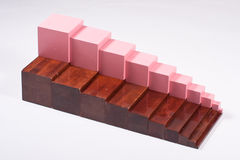 Montessori Learning Materials: Brown Stairs and Pink Tower. Combination of Montessori Pink Tower and montessori Brown Stairs - educational material for stock photos