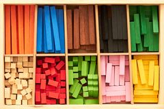 Wood Montessori material for math Cuisenaire rods. Montessori material for playing wile learning geometry and math stock photography