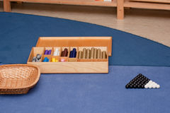 Montessori Method - Mathematical Material. Bead Stairs - montessori educational material for addition and subtraction activities stock image