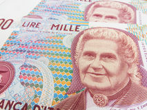Montessori over an old one thousand Lire  Italian bill. Montessori  over an old one thousand Lire  Italian bill Royalty Free Stock Photography