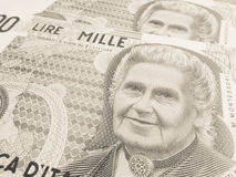 Montessori over an old one thousand Lire  Italian bill Royalty Free Stock Photography