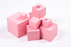 Montessori Pink Cubes. Montessori Pink Tower building blocks - sensorial material for elementary education stock image
