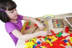 Montessori puzzle. Preschool. Stock Photo