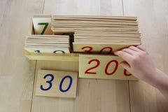 Montessori-Puzzlespiel. Vorschule. Lizenzfreie Stockbilder