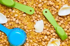 Montessory sensory texture experimentation in school. With chickpea and pasta Stock Photo
