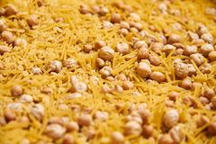 Montessory sensory texture experimentation in school. With chickpea and pasta Royalty Free Stock Images