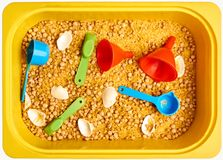 Montessory sensory texture experimentation in school. With chickpea and pasta Royalty Free Stock Image