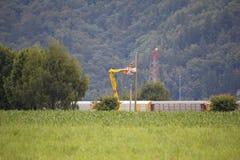 Monteurs de lignes ruraux Images stock