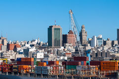 Montevideo cityscape from port district. Montevideo, Uruguay - December 15, 2012: Montevideo cityscape from port district - Containers at the port, on the ship Royalty Free Stock Photo