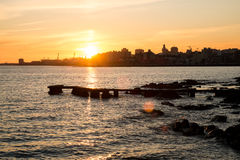 Montevideo. Sunset over Rio de la Plata with Montevideo skyline in the background Royalty Free Stock Photos