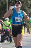 MONTEVIDEO, URUGUAY – SEPTEMBER 24, 2017: runner hydrating in the Global Energy race. Stock Photography