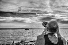 The Plane Show. MONTEVIDEO, URUGUAY, NOVEMBER 20, 2016: A photographer in a sky show in the afternoon in Montevideo, Uruguay on November 20, 2016 Stock Photos