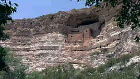Montezuma Castle National Monument. Ancient Indian dwelling ruins near Camp Verde, Arizona, USA. The dwellings were built and used by the Sinagua people, a pre stock video footage