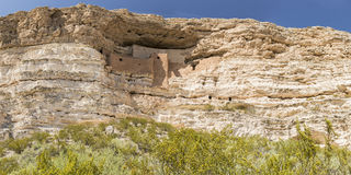 Montezuma Castle and Wildflowers Panorama Stock Images