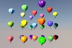Montgolfiers multicolores que vuelan en el cielo Imagenes de archivo