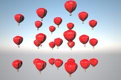 Montgolfiers rojos que vuelan en el cielo Imagen de archivo libre de regalías