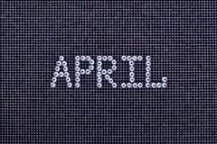 Month APRIL is made rhinestones crystal color on a black canvas Stock Photos