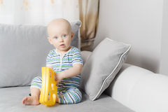6-month baby boy crying while mother is changing his nappy stock image