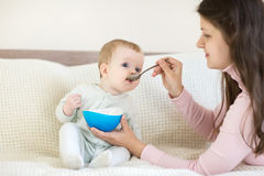 8 month baby eating from the bowl Stock Images