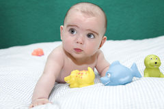 6 month baby lying on the bed stock photo
