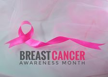 Month Breast Cancer Awareness Ribbon in October. Pink ribbon symbolic of Breast Cancer Awareness Month.The Campaign aims to shift public focus from awareness Stock Photo