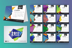12 month desk calendar template. For print design with abstract polygon background. 2017 calendar design start with Sunday. 7x5 inches size with bleeds vector royalty free illustration