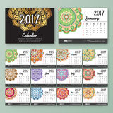 12 month desk calendar template. For print design with colored Mandala background. 2017 calendar design start with Sunday. 7x5 inches size with bleeds vector stock illustration