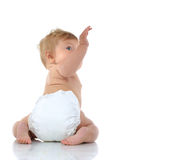 6 month infant child baby toddler sitting with raised hand up Stock Photos
