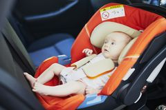 2 month old baby girl in car seat stock images
