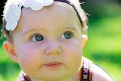 6 Month Old Baby Girl Outdoors Stock Image