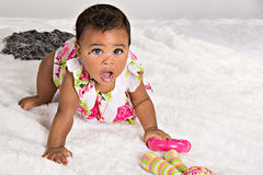 7 month old girl crawling. 7 month old baby girl, crawling royalty free stock photo