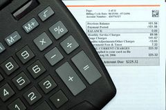 Monthly Bill. This is an image of monthly bill and a calculator royalty free stock images