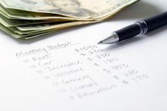 Monthly budget planning. Sheet with pen and US dollars stock images