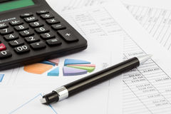 Monthly budget spreadsheet, pen and calculator. A Monthly budget spreadsheet, pen and calculator Royalty Free Stock Image