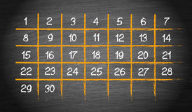 Monthly Calendar with 30 days. On blackboard background royalty free illustration