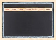 Monthly calendar with week words print. On wood on blackboard Stock Images