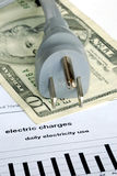 The monthly electric bill is very expensive. The monthly electric charge is very expensive Stock Image
