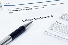 Monthly Financial Statement. Close up monthly financial statement with pen Royalty Free Stock Photo