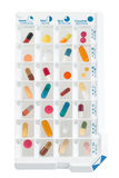 Monthly pills planner with a daily dose of medications in each cell Stock Photos