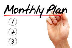 Monthly plan. Hand writing monthly plan with marker, business concept Royalty Free Stock Images