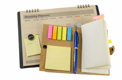 Monthly planner with pen and notedbook Stock Photography