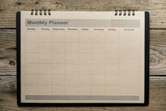 Monthly planner on the wooden table background Royalty Free Stock Images
