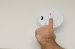 Monthly smoke detector test Royalty Free Stock Image