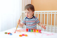 20 months baby boy painting at home Royalty Free Stock Images