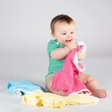10 months baby girl choosing clothes Stock Image