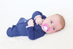 2 months baby girl  with soother Stock Photography