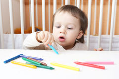 18 months baby paints Stock Photo