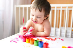 18 months baby with paints Royalty Free Stock Image