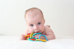 4 months baby plays educational toy teether. At home royalty free stock images